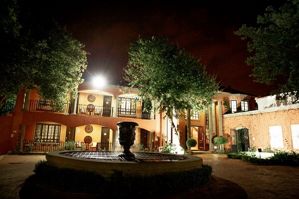Night Photo of Ivory Manor with Fountain